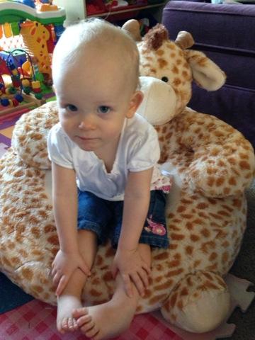 In her giraffe chair